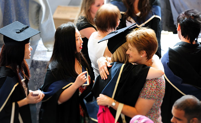 People hugging at a Graduation ceremony